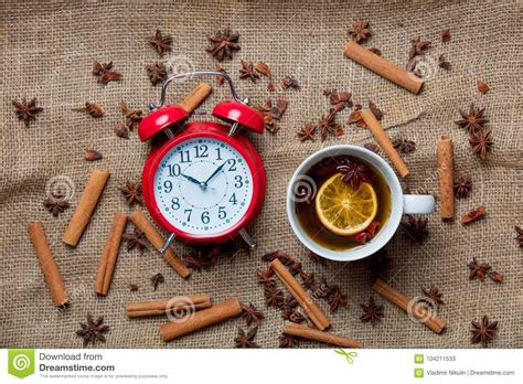cup of tea with alarm clock and ingredients stock image image 104211533