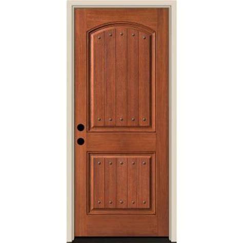 Belmont Door by Tru Tech Belmont 2 Panel Plank With Clavos Oak Finish