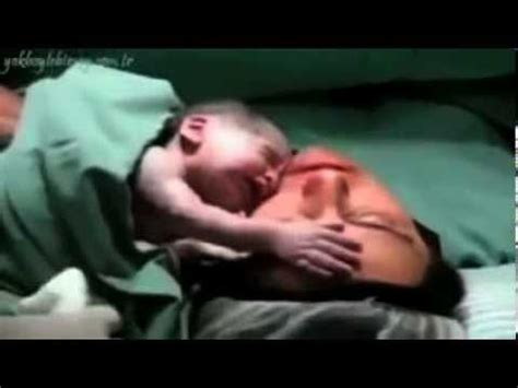 newborn baby after c section new born baby clings to his mother after c section youtube