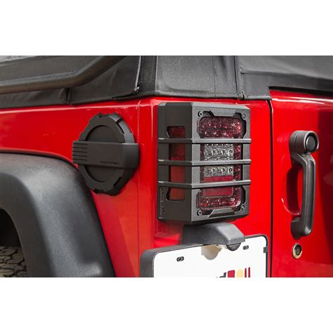 jeep tail light guard rugged ridge 11226 05 elite tail light guards black 07