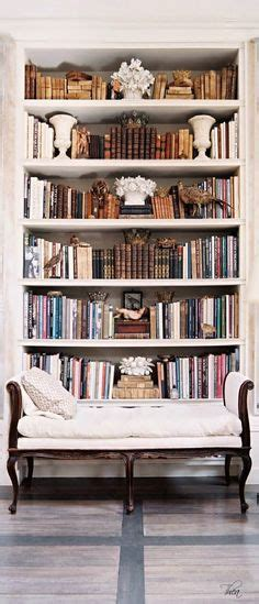 1000 ideas about arranging bookshelves on