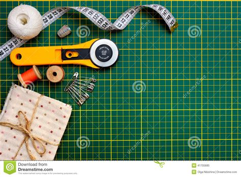 Patchwork Tools And Equipment - patchwork sewing tools on green mat stock image image