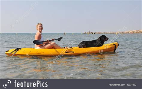 kayak commercial blonde woman and dog on a kayak picture
