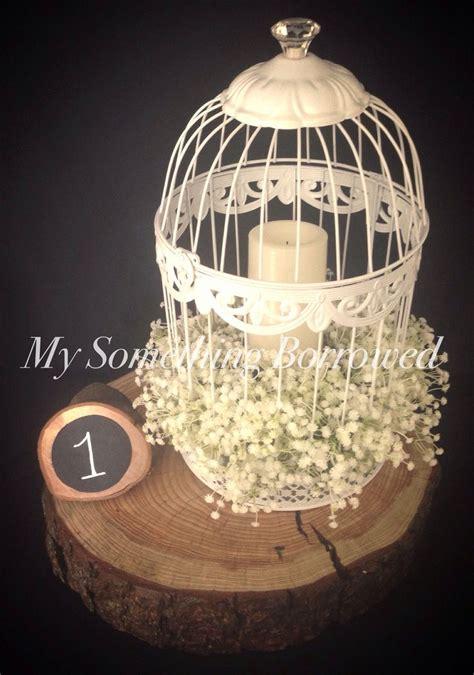 centerpieces using photos 25 best ideas about birdcage centerpiece wedding on