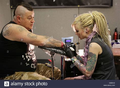 tattoo convention brighton uk female tattoo artist at work at the annual brighton tattoo
