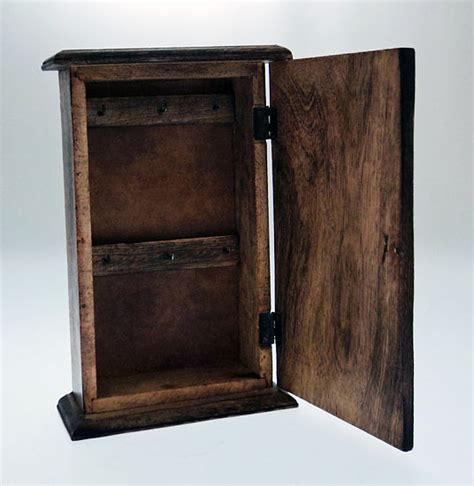 Wood Key Cabinet by Carved Wood Swirl Design Wooden Key Cabinet Safe