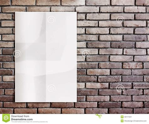 template white crumpled poster on grunge brick wall and