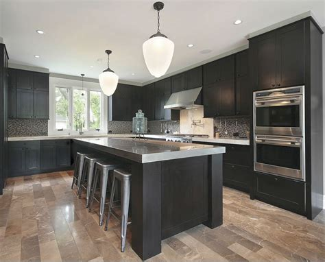 gray cabinets with black countertops dark cabinets grey countertops and light wood floors