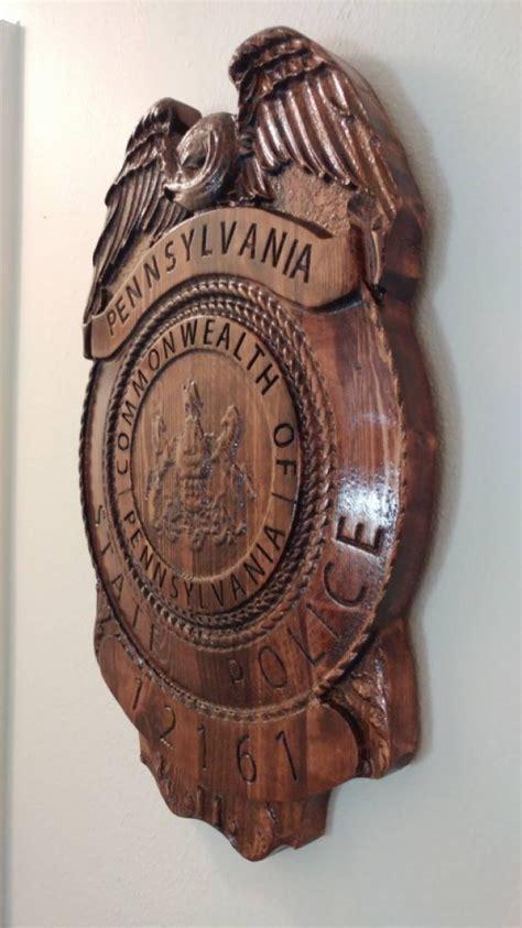 carved pennsylvania state trooper police badge wood