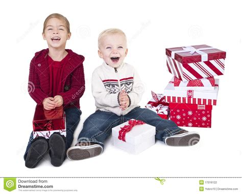 Excited Children Opening Their Christmas Gifts Stock ... Happy Kids Opening Christmas Presents