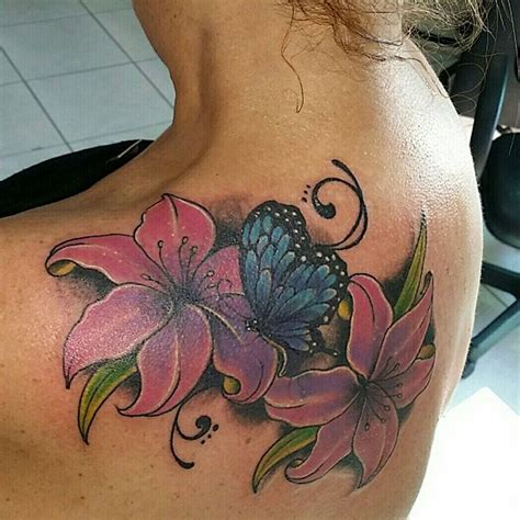 butterfly on flower tattoo designs 28 awesome butterfly tattoos with flowers that nobody will