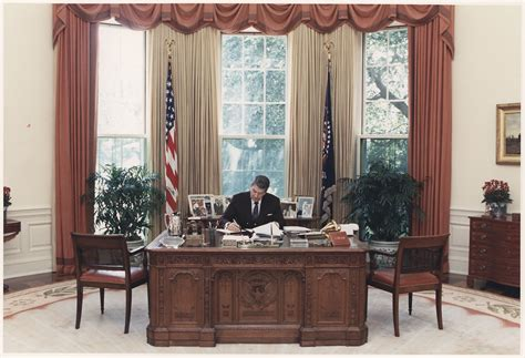 File Photograph Of President Reagan Working At His Desk In White House Oval Office Desk