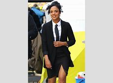 Tessa Thompson reveals trademark black tie and suit while ... International Trademark Suit