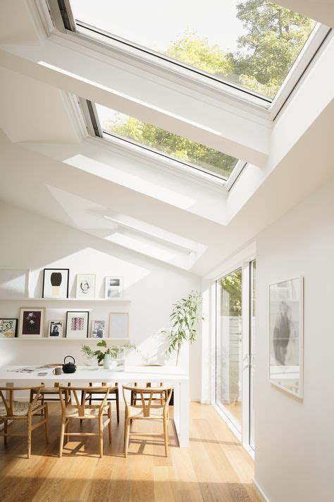 bright scandinavian dining room with roof windows and