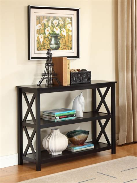 Wall mounted picture frame above small wood console table with shelf and rattan basket storage