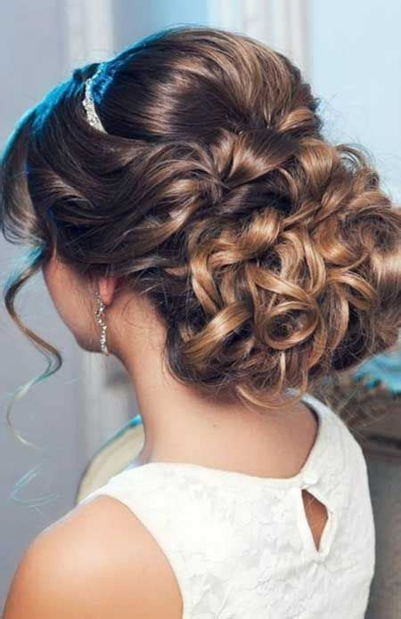 hairstyles curly hair tied up elegantly tied up bun with bouncy top wedding hairstyles