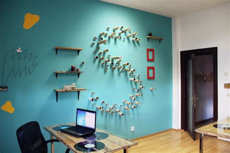 office wall decorations color and personality webshake office in bucharest by archinteriors freshome