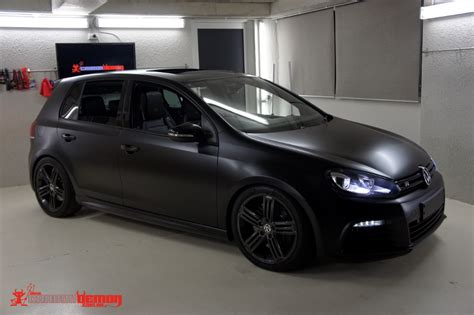 black volkswagen golf vw golf r matte black vinyl wrap