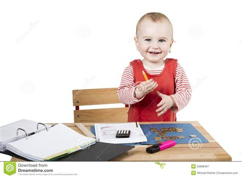 Kid At Desk by Child At Writing Desk Royalty Free Stock Photography