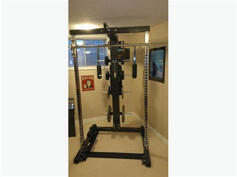 self spotting weight bench ironmaster gym with bench dumbbells weights and
