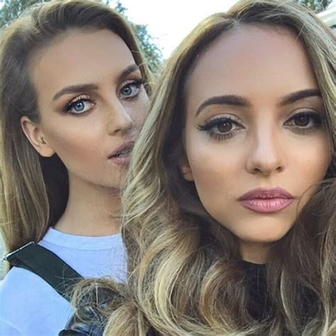 band members perrie edwards & jade thirlwall pose for an