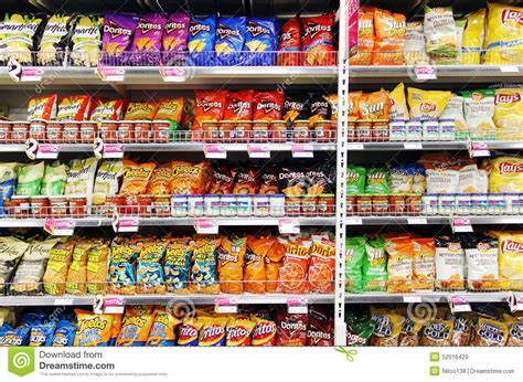 Shelf Of Potato Chips by Potato Chips And Snacks In Supermarket Editorial Stock