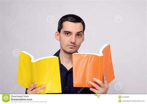 raising royalty books looking amazed at the books raising his eyebrow