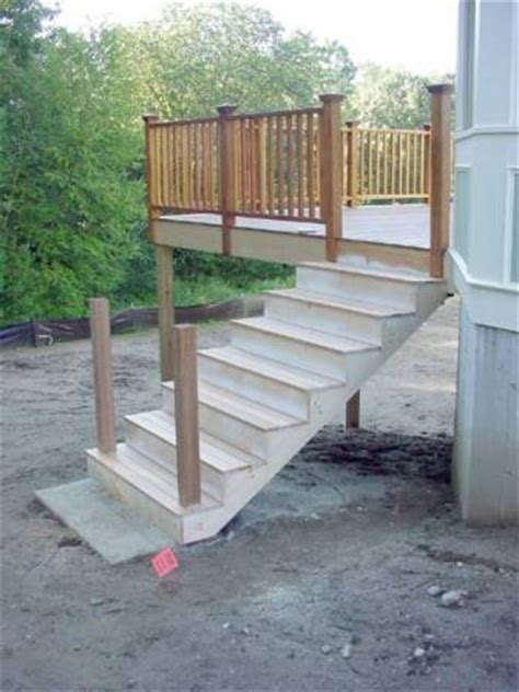 Building Deck Stairs by How To Build A Deck The Basics Of Deck Construction