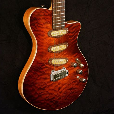 crafted quilted maple drop top guitar by snider