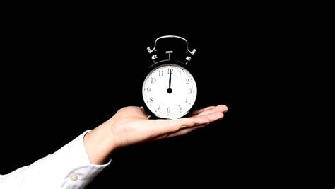 stock video  hand hold alarm clock    shutterstock