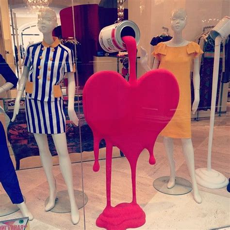 valentines day store moschino shop window display pouring paint