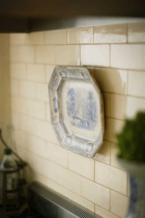 off white subway tile Kitchen Traditional with antique