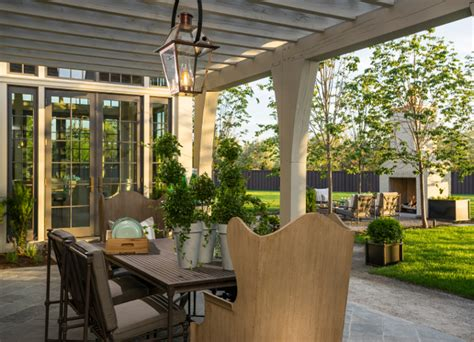Patio Furniture Pergola Family Home With Timeless Interiors Home Bunch