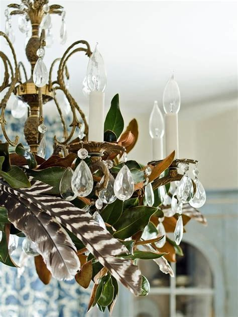 decorating with magnolia leaves chandelier with magnolia leaves and feathers the fox