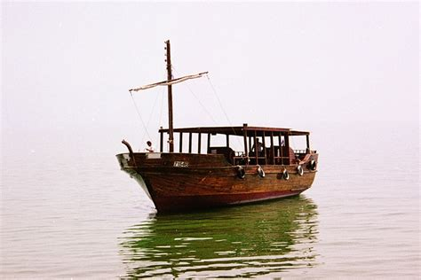 fishing boat in jesus time the bible journey jesus crosses the sea of galilee