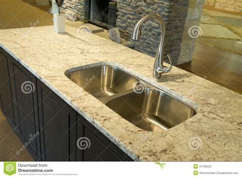 modern kitchen sink with granite counter top stock photo