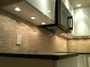 installing cabinet puck lighting puck lights microwave fan modern kitchen vancouver