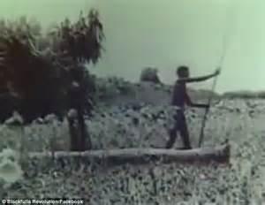 row the boat crocodile incredible footage shows aborigines hunting for crocodiles
