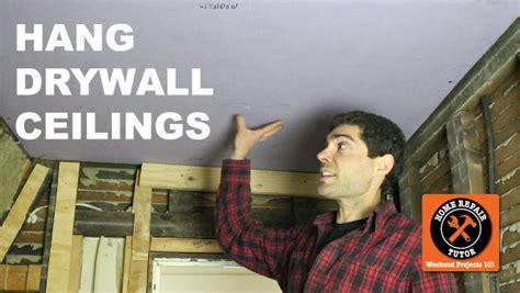 hang drywall ceiling how to hang drywall ceilings by yourself home repair tutor
