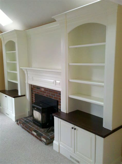 white built in white built in bookcases around fireplace picture