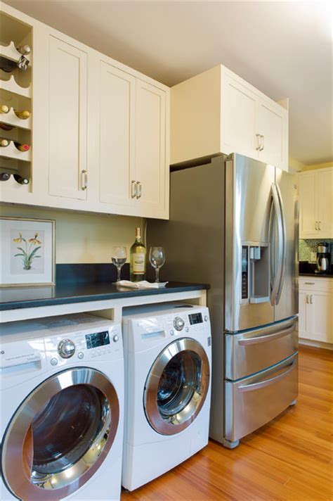 washer dryer in kitchen cape cod beach house remodel beach style kitchen