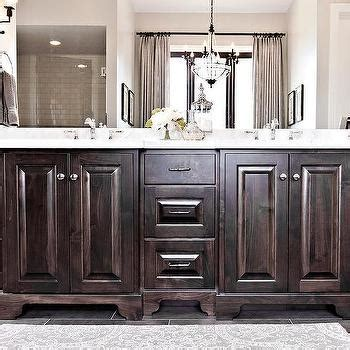 staining bathroom cabinets darker dark stained washstand with feet under framed mirrors