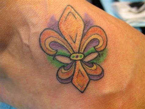 fleur de lis detailed tattooimages biz coloured fleur de lis on foot tattooimages biz