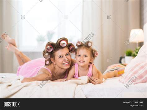 fun in the bedroom stock photo 169 deklofenak 4604241 mom daughter bedroom on bed curlers image photo bigstock