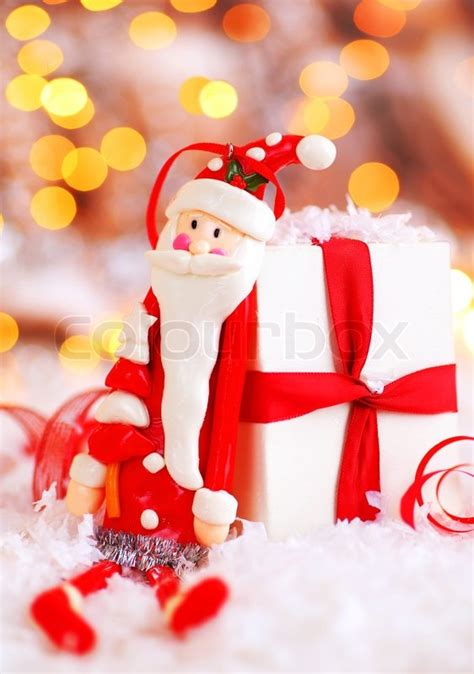 img of santa claus and x mas tree background with santa claus tree decorative ornament gift box in snow