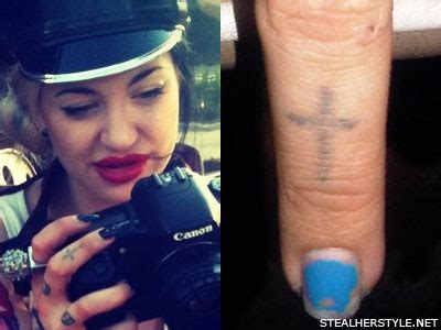 cross tattoo on your middle finger porcelain black s tattoos meanings steal her style