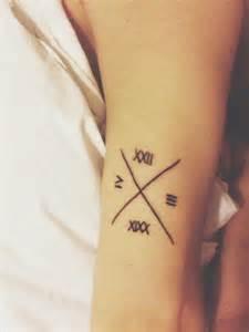 roman numeral tattoo 25 amazingly hot roman numeral tattoos inkdoneright