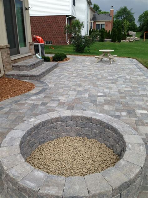 Stone patio with built in fire pit   Outdoor spaces