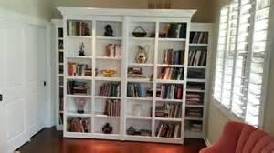 Murphy Bed Bookshelf Plans White Murphy Bed With Pivoting Library Bookcases