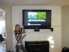 Dana is happy to show off her new tv installed over her fireplace